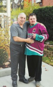 Staff photo/NICK PERRY  Joe Rizzuto, left, and his son, Mark. The elder Rizzuto joined the Grandravine Special Program 21 years ago and has been president of the program since 003.